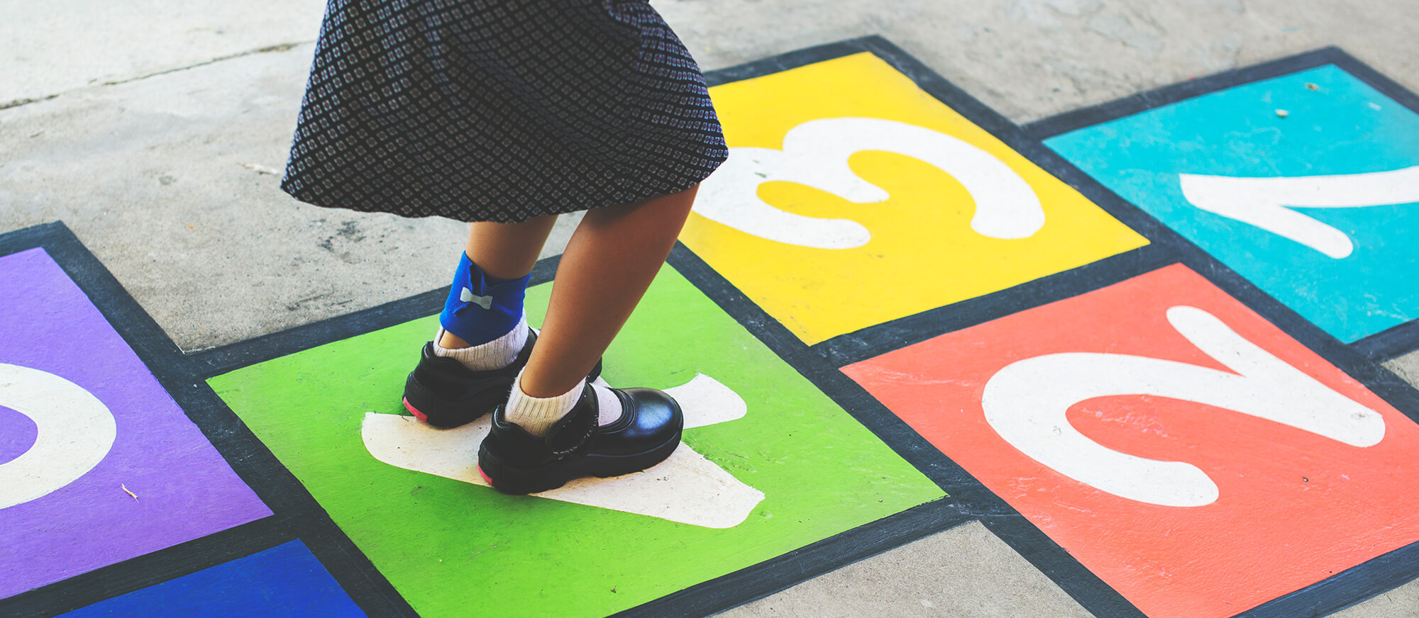 young-girl-playing-hopscotch-PUSTBA3